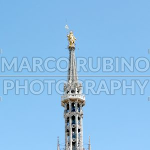 The Madonnina Statue on the roof of Milan Gothic Cathedral, Italy