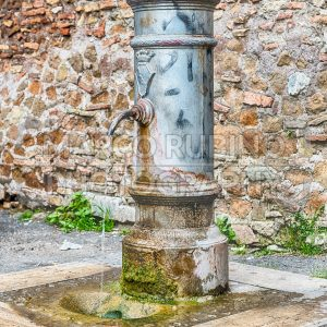 Traditional free water public fountain in Rome, Italy