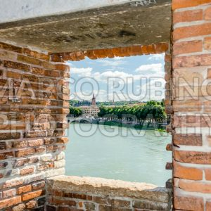 Window with view over Adige River in Verona, Italy