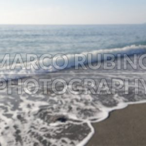 Defocused background of a scenic beach in Calabria, Italy