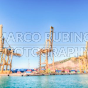 Defocused background of container cranes in Barcelona, Catalonia, Spain - Marco Rubino | Photography - Inspiring imagery for creative projects