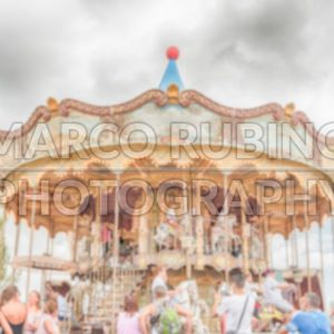 Defocused background of old vintage carousel at in amusement park
