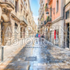 Defocused background of street in Ribera district, Barcelona, Catalonia, Spain