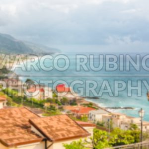 Defocused background with aerial view of coastline in Calabria, Italy