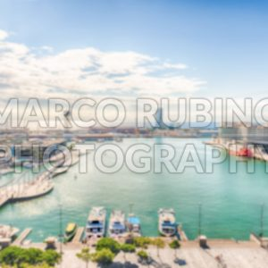 Defocused background with view of Port Vell, Barcelona, Catalonia, Spain