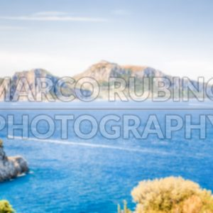 Defocused background with view of the Island of Capri, Italy