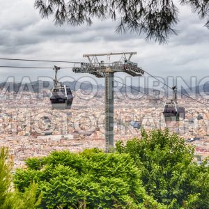 Montjuic Cable Cars and cityscape on background, Barcelona, Catalonia, Spain
