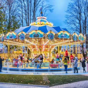 Old fashioned carousel in amusement park at dusk