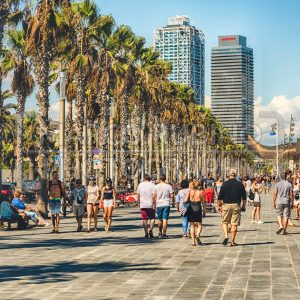 Walking on the promenade of Barceloneta beach, Barcelona, Catalonia, Spain
