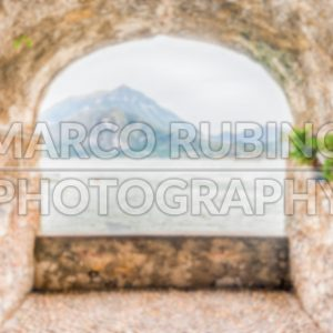 Defocused background of rock balcony facing Lake Como, Varenna, Italy