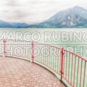 Defocused background with balcony over the Lake Como, Italy