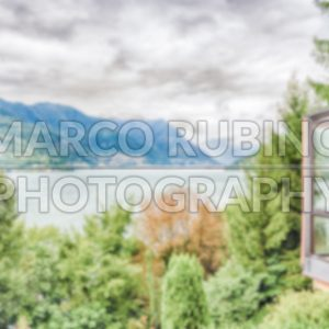 Defocused background with scenic landscape over the Lake Como, Italy