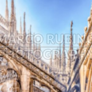 Defocused background with spiers of the Cathedral of Milan, Italy