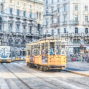 Defocused background with trams operating in Milan, Italy