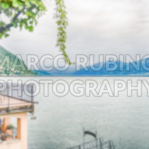 Defocused background with view over Lake Como from Varenna, Italy