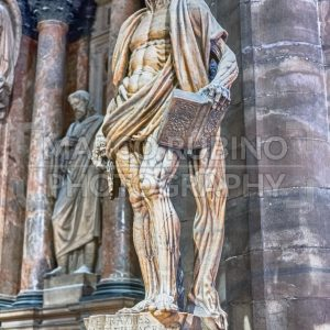 Statue of Bartholomew the Apostle inside Milan Cathedral, Italy