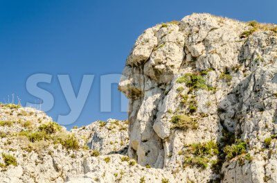 Anthropomorphic rock on a beach in Milazzo, Italy Stock Photo