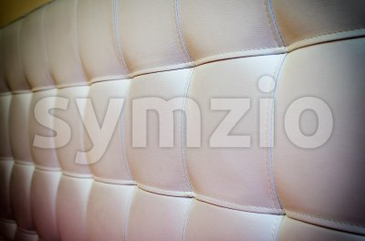 Tufted white leather headboard texture for background with vignette Stock Photo