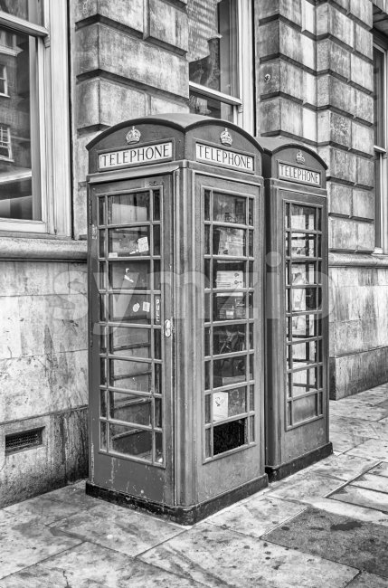 Traditional british red phone booth in London, UK Stock Photo
