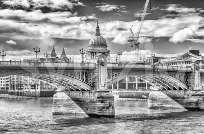 View of St. Paul Cathedral over Southwark Bridge, London, UK Stock Photo