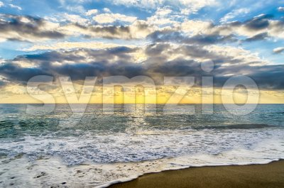 Sunset on the sea with a scenic cloudy sky, Italy Stock Photo