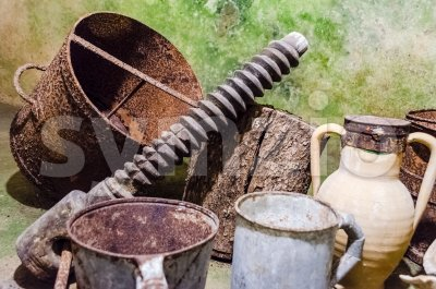 Rusty tools in an ancient underground oil mill in Italy Stock Photo