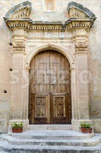 Ancient door in old town of a southern Italy village Stock Photo