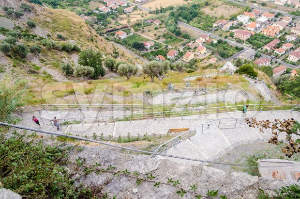 Serpentine road ascending the hill in a southern Italy village Stock Photo
