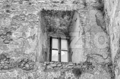 Ancient window from the ruins of an old castle Stock Photo