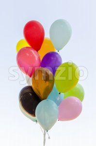 Colorful bunch of helium balloons Stock Photo