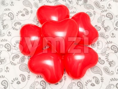 Composition of Red Heart shaped balloons on a blanket Stock Photo