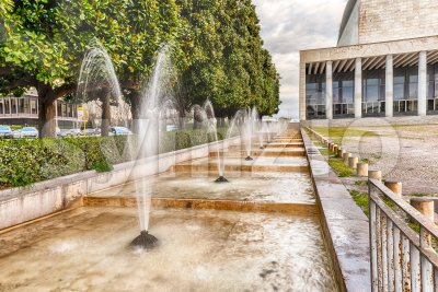Scenic fountain, neoclassical architecture in the EUR district, Rome, Italy Stock Photo