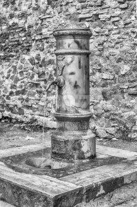 Traditional free water public fountain in Rome, Italy Stock Photo