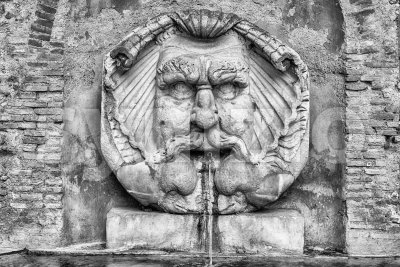 Fountain with mask, Rome, Italy Stock Photo