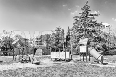 Deserted playground for kids inside a urban public park, Italy Stock Photo