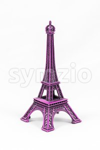 Purple Eiffel Tower model, isolated on white background Stock Photo