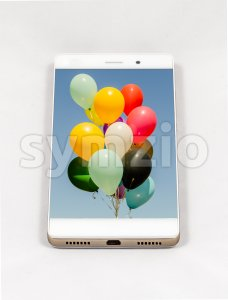 Modern smartphone with full screen picture of balloons on display Stock Photo