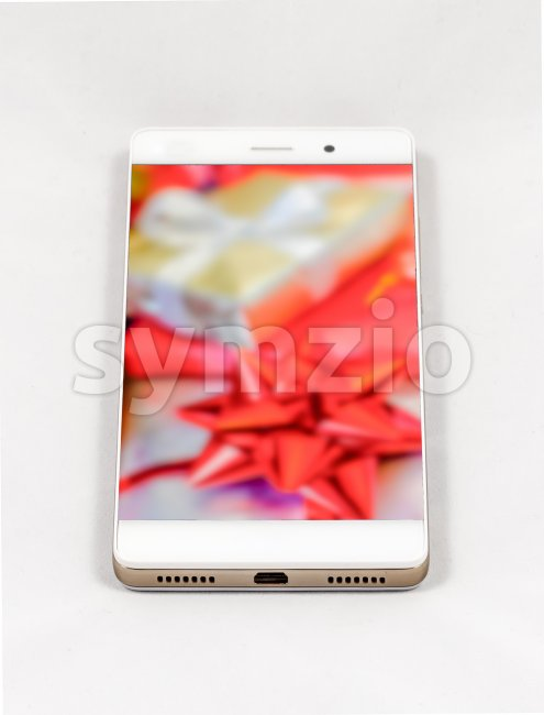 Modern smartphone displaying full screen picture of Christmas gifts Stock Photo