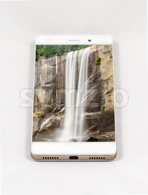 Modern smartphone displaying full screen picture of a waterfall Stock Photo