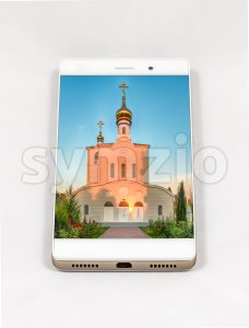 Modern smartphone displaying full screen picture of orthodox church, Russia Stock Photo