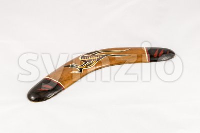 Brown wooden decorated australian boomerang Stock Photo