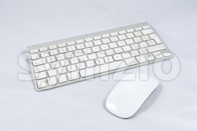 White wireless computer keyboard and mouse Stock Photo