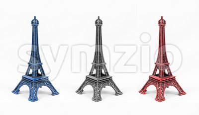 Three multicolored Eiffel Tower models, isolated on white background Stock Photo