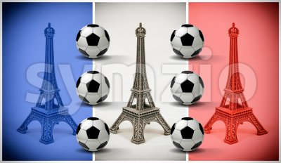 Multicolored Eiffel Tower models with french flag and soccer balls Stock Photo