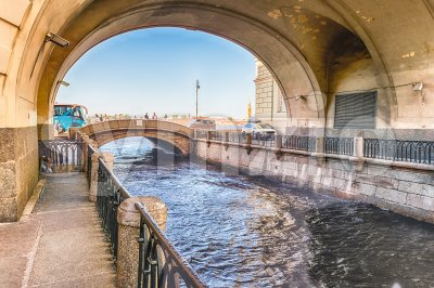 Winter Canal with Arch over Hermitage Bridge, St. Petersburg, Russia Stock Photo