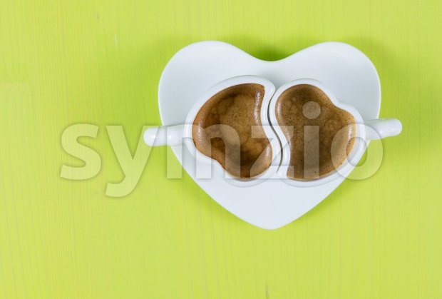 Flat lay with two cups of espresso on green board Stock Photo