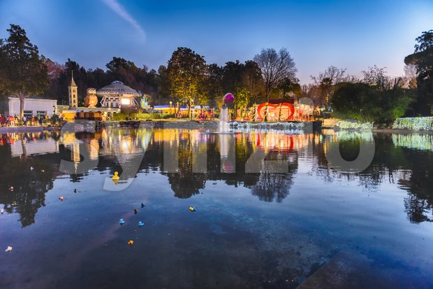 Scenic pond inside an amusement park Stock Photo