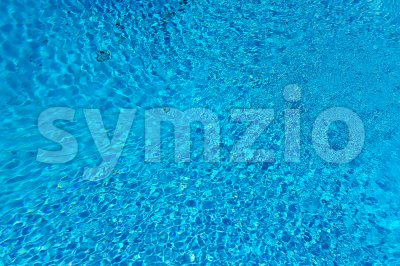 Blue water surface and ripple wave in swimming pool Stock Photo