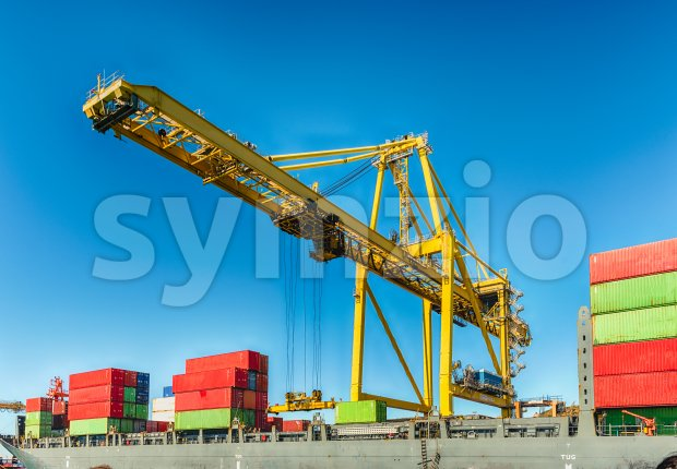 Container crane at the commercial port of Barcelona, Catalonia, Spain Stock Photo