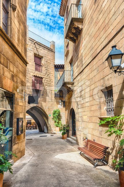 Scenic alley inside Poble Espanyol, an open-air architectural museum on the Montjuic hill in Barcelona, Catalonia, Spain
